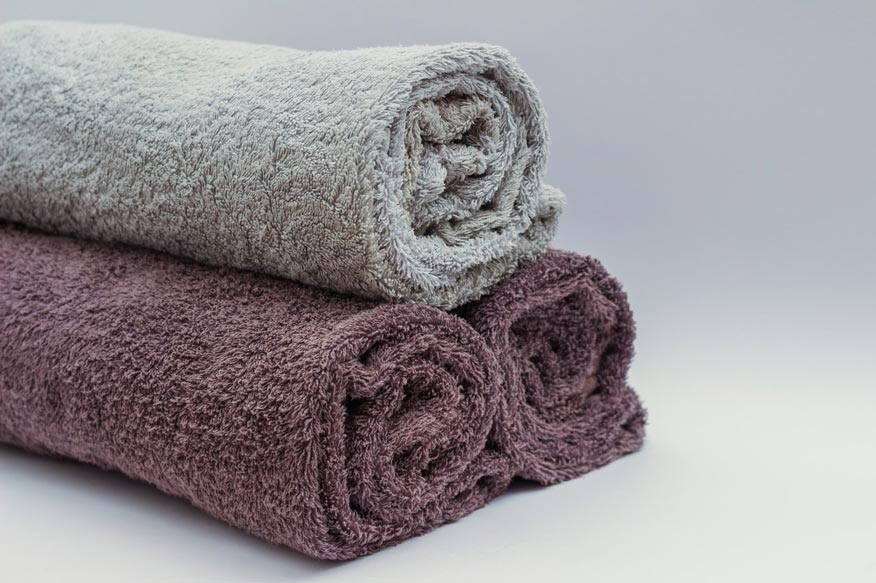 rolled up bathroom towels