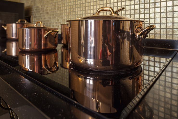 copper pans on the stove