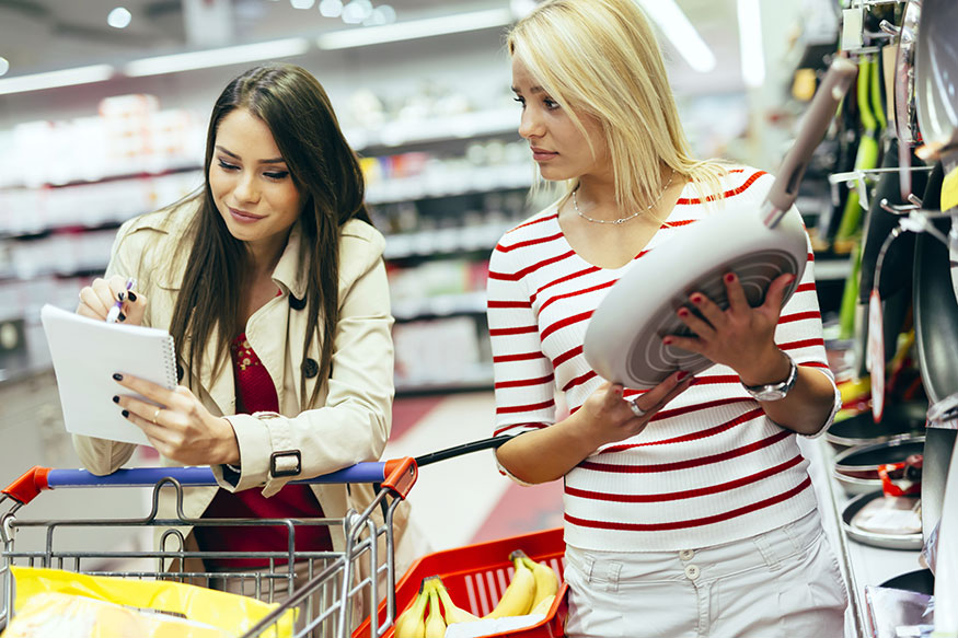 women shopping for cookware
