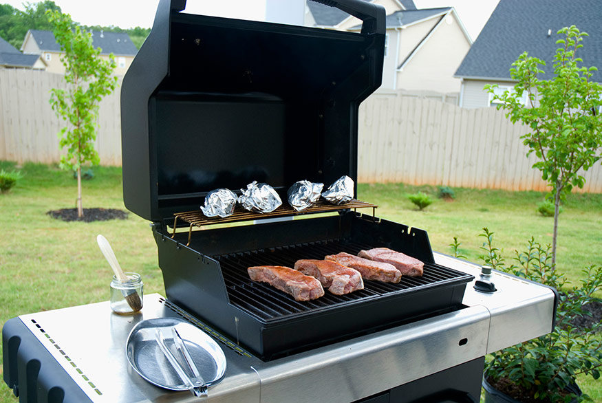 gas grill with food on it