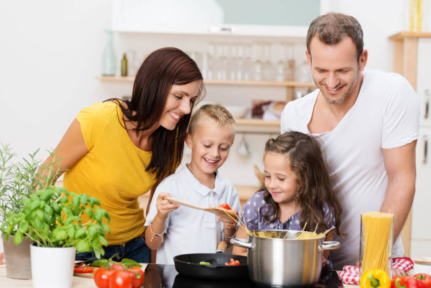 happy family cooking with safe cookware