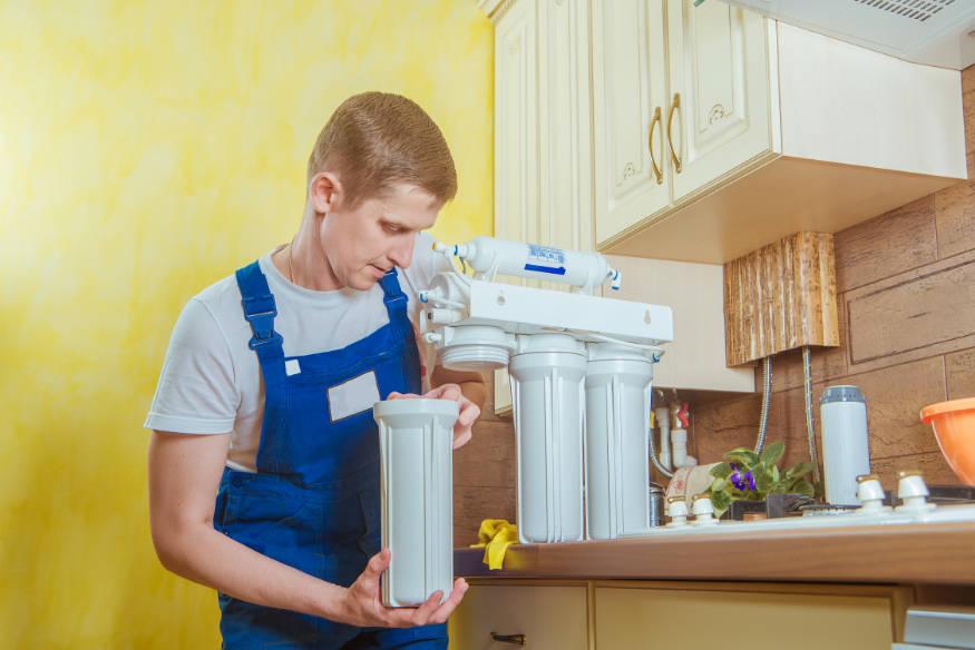 man working on water filter