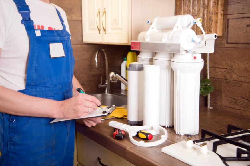 plumber installing reverse osmosis system