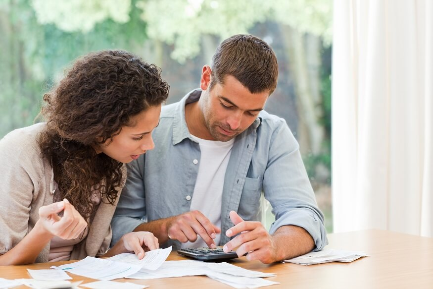 couple calculating running cost of an infrared heater