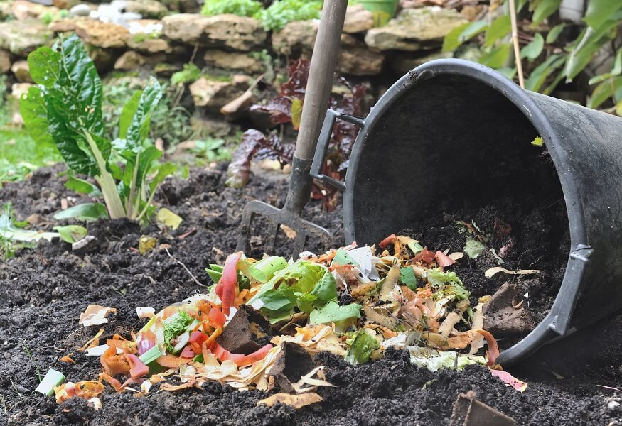 mixing brown and green materials for compost