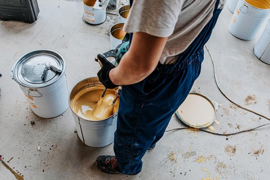 man mixing resin