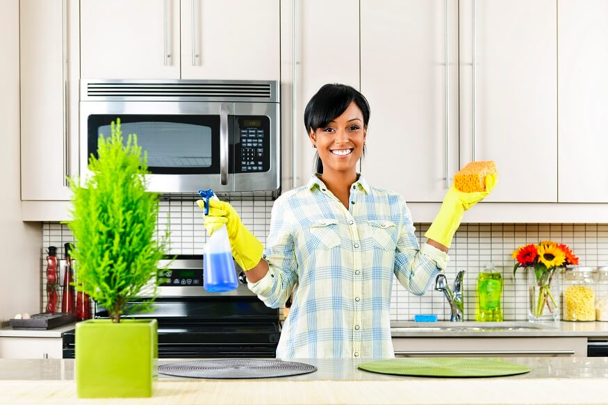 woman cleaning countertop