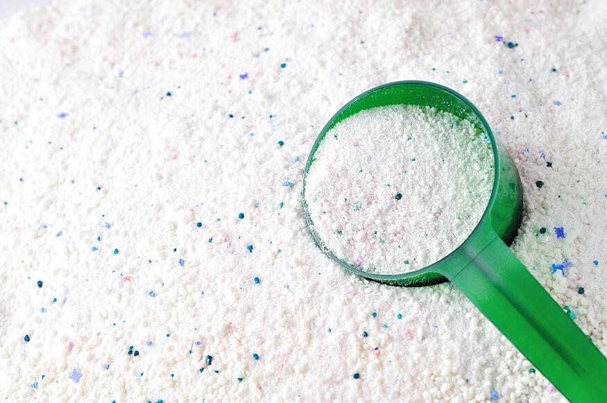 adding powdered detergent to absorb and lift oil