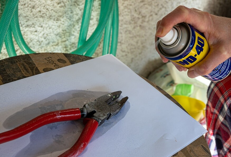 WD-40 can remove oil from garage