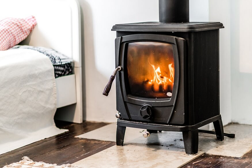 wood burning stove in the bedroom