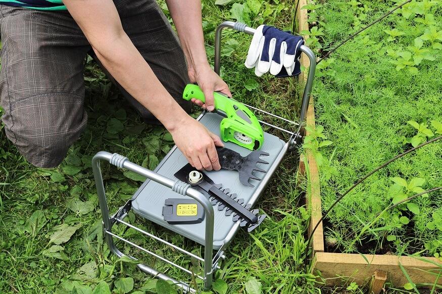 man setting up his cordless grass shears