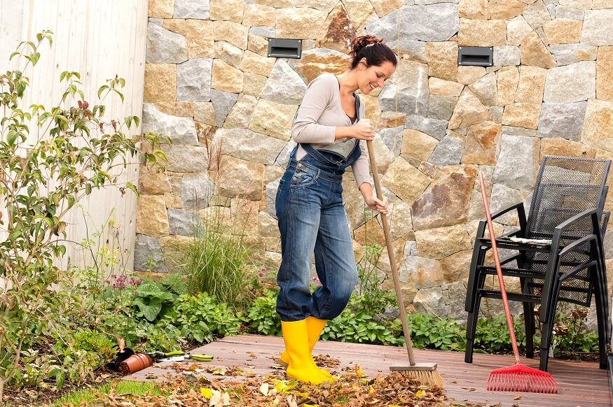woman cleaning the backyard