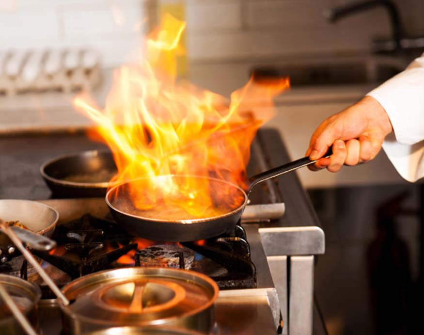 chef cooking with copper pan