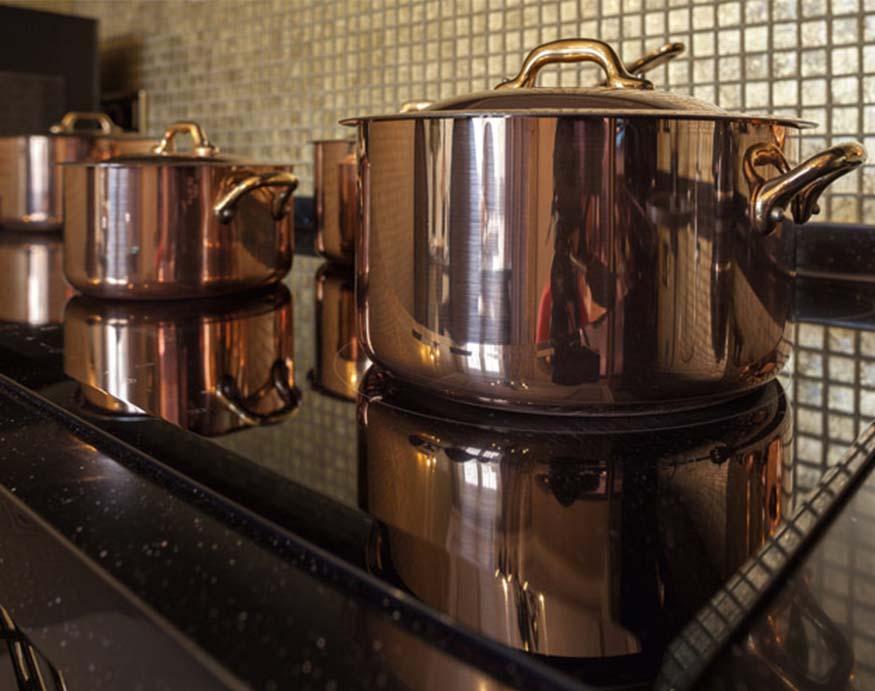 copper pots on stove