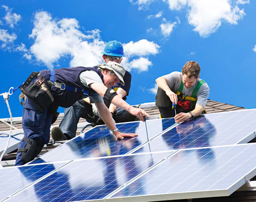 men installing solar power panels