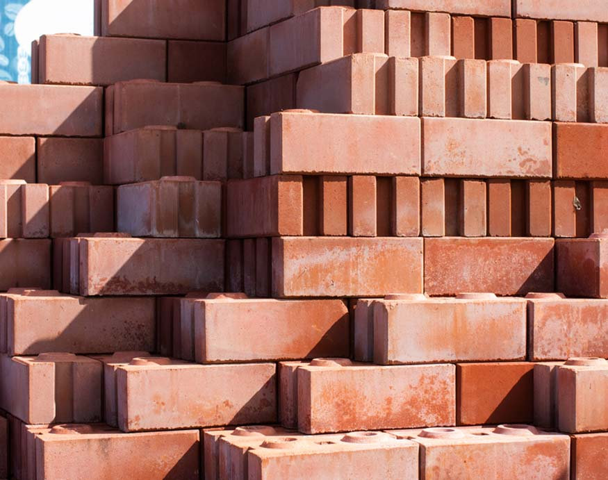 stack of red bricks for heating a greenhouse