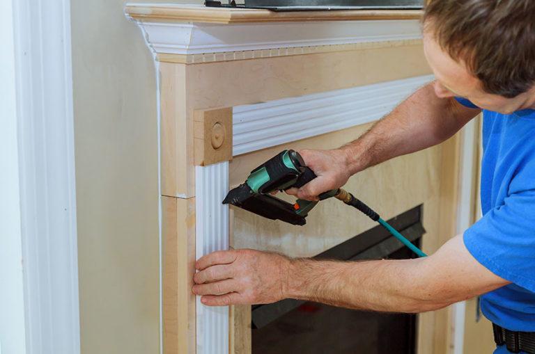 guy installing fireplace insert