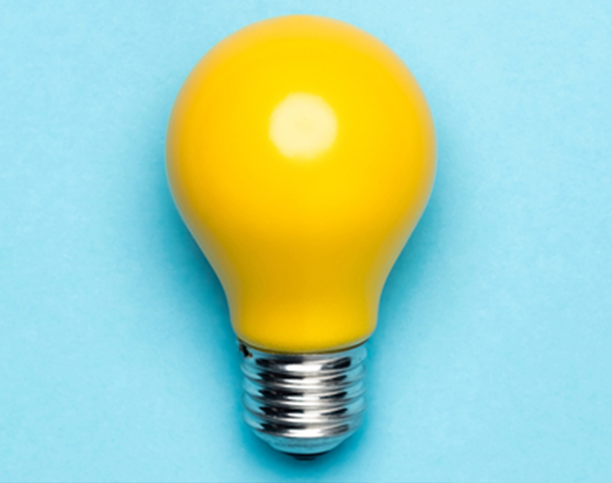 Yellow light bulb on a blue background