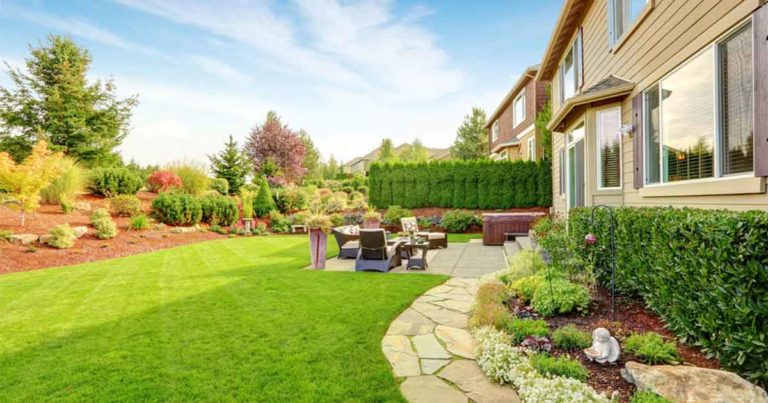 house with healthy lawn