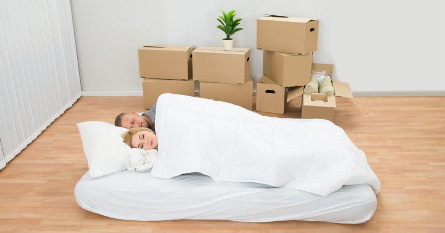 couple sleeping on a floor mattress