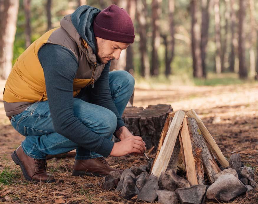 man building a fire