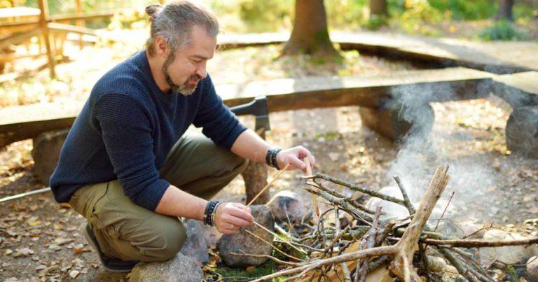 man starting a fire