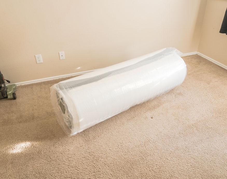 rolled up floor mattress