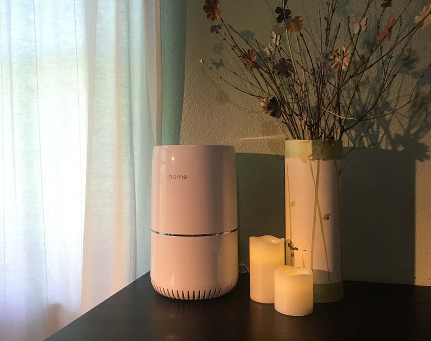 h0melabs purely awesome air purifier on a nightstand