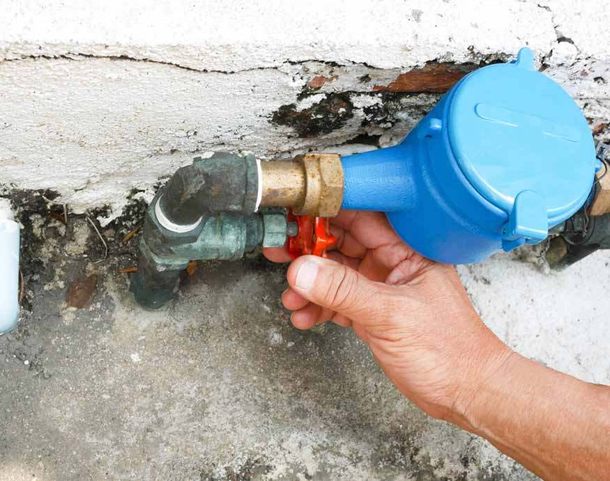 man opening the water valve