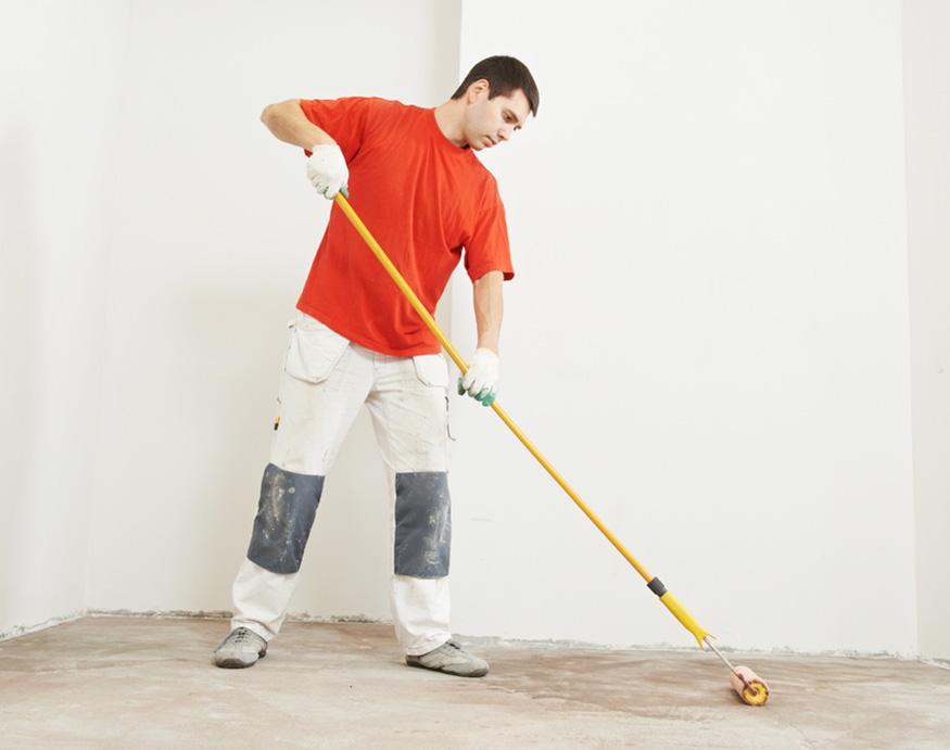man priming floor