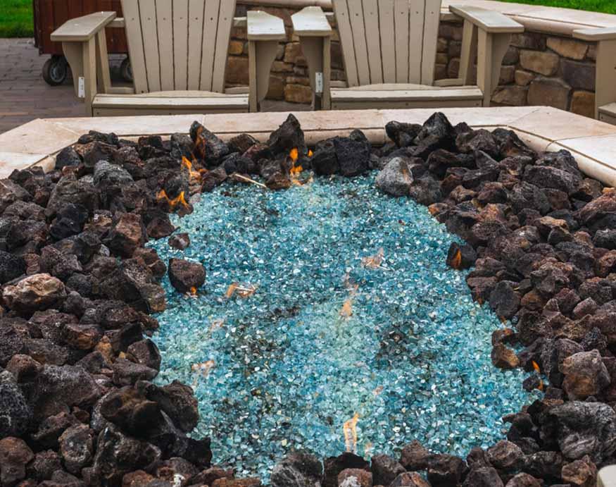fire glass rocks surrounded by lava rocks