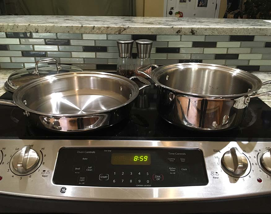 picture of 360 Cookware saute pan and stockpot on top of an induction stove