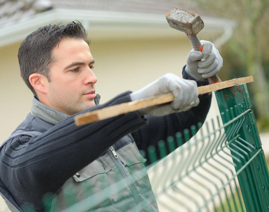 man fixing fence