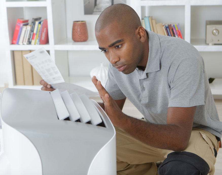 man reading the instruction manual of a portable air conditioner