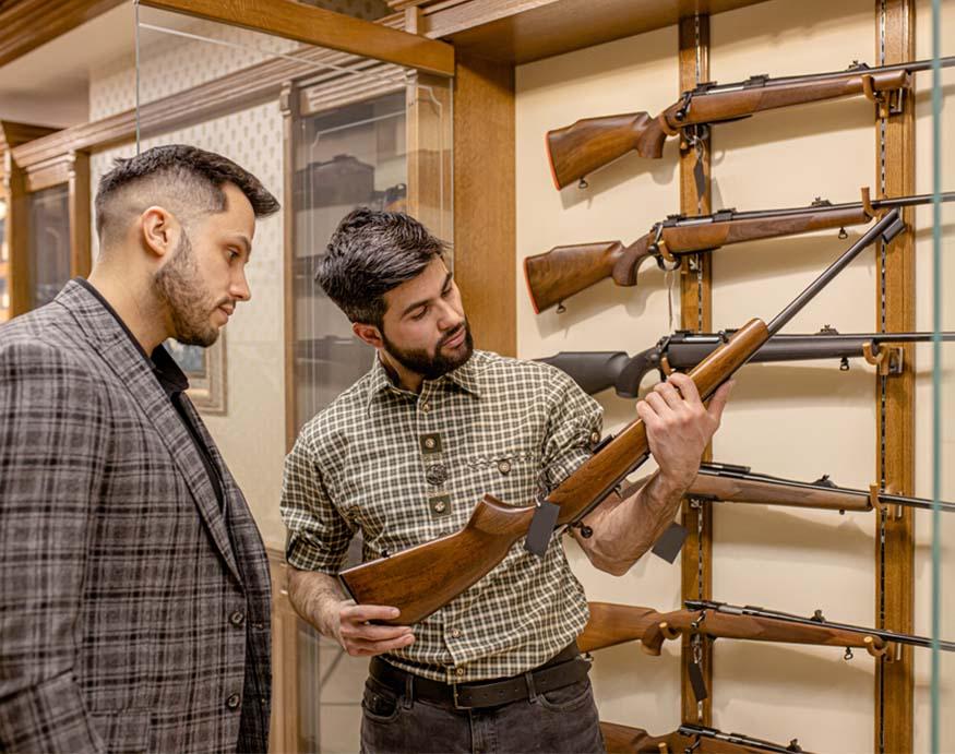 man showing a gun