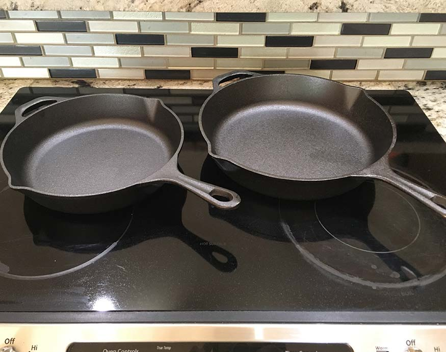 Uno Casa cast iron pans on top of a glass stove