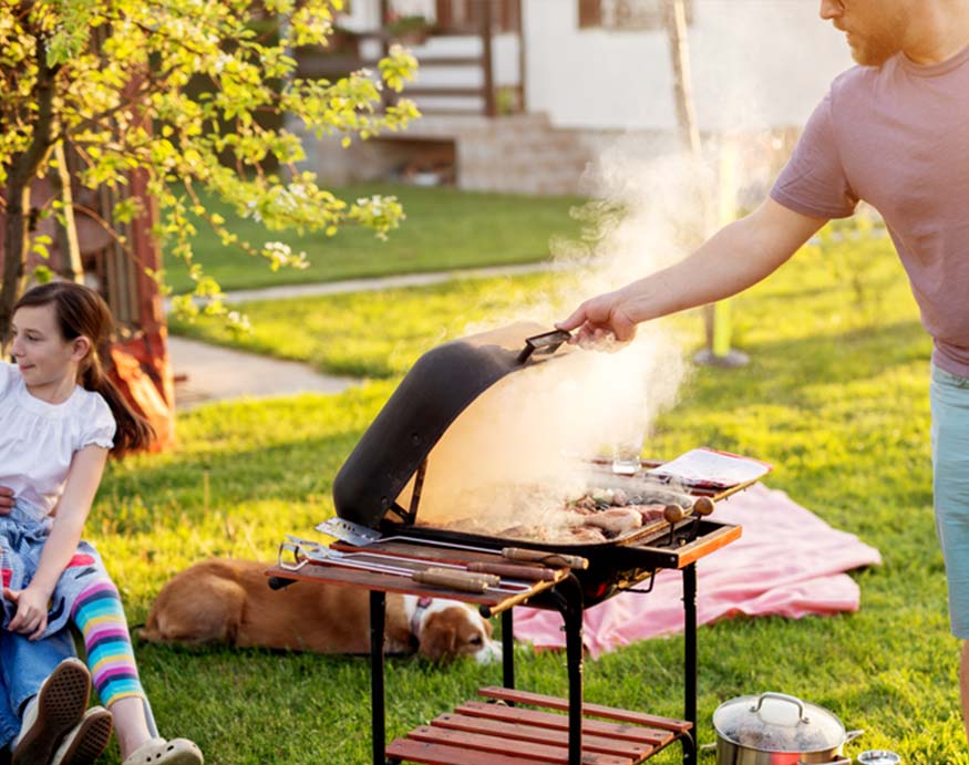 man cooking in the backyard