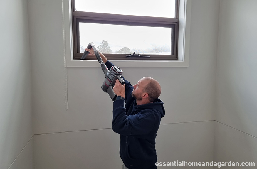 man using roborock h7 vacuum