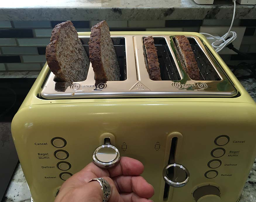 using the front lever of the Buydeem 4-Slice Toaster