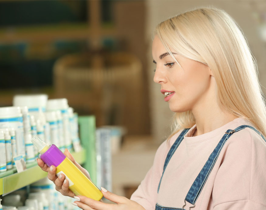 woman selecting the best mosquito repellent for dogs