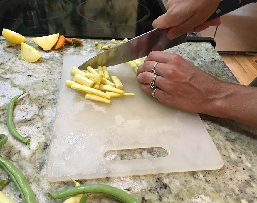 A person gripping a Misen Chef's Knife