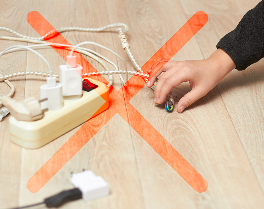 A person attempting to touch a frayed cord