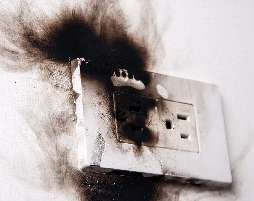 A picture of burned electrical outlet