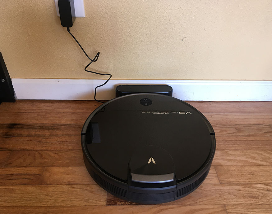 Viomi V3 Max plugged into its charging base