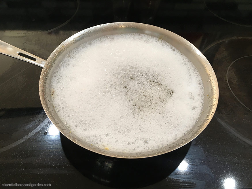 using soapy water to clean stainless steel pan