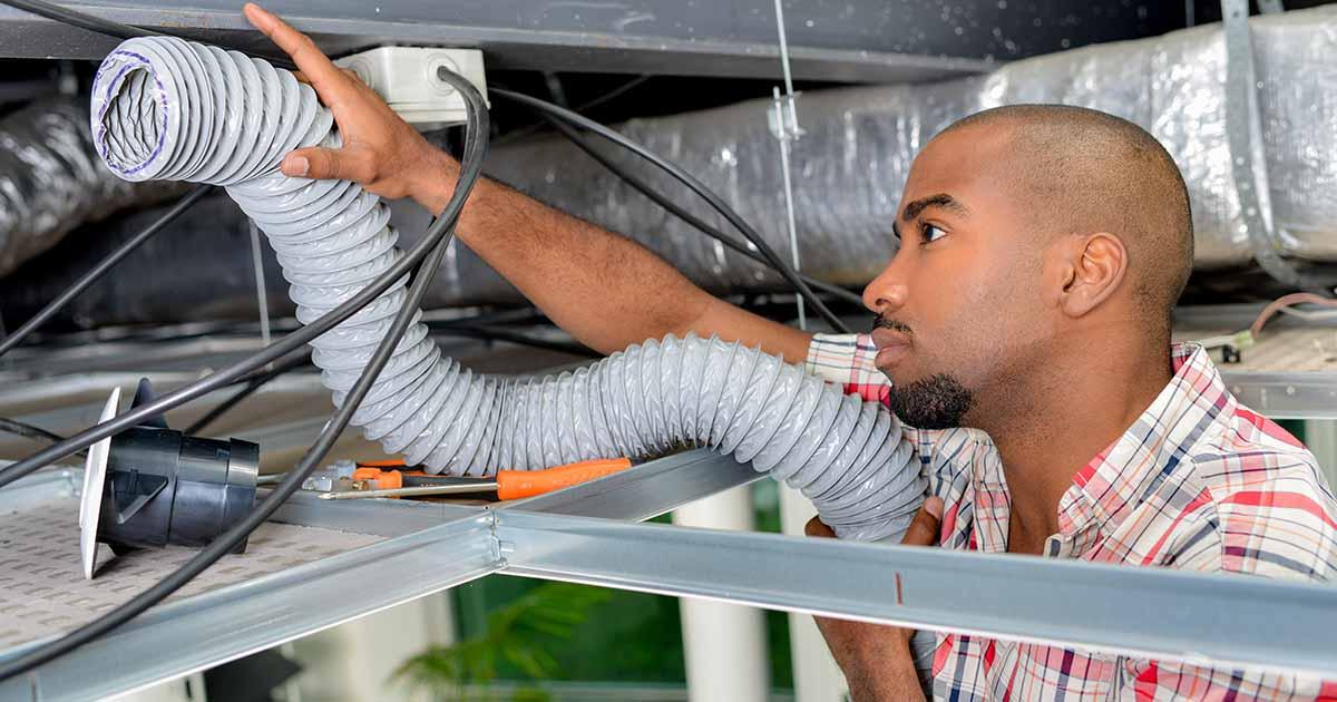 an electrician installing a whole house dehumidifier