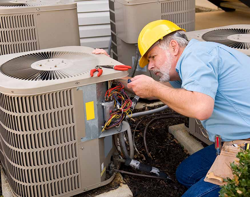 a repairman fixing a HVAC ac unit