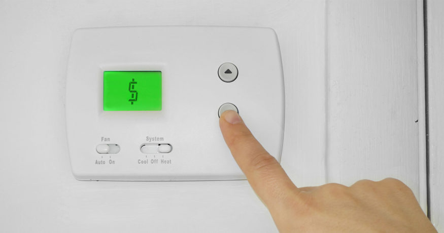 turning down the thermostat to save money